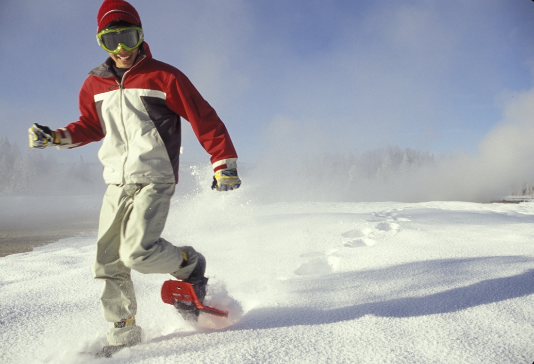 Young man snowshoeing